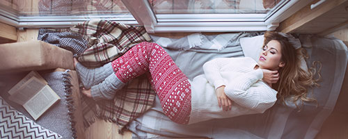 Woman sleeping on the floor in winter time